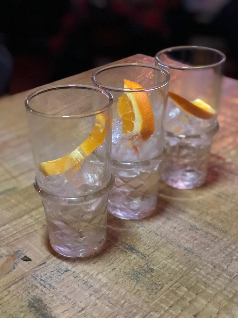 Three gins in gin glasses